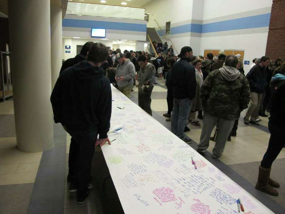 Hundreds of students, along with parents and teachers staged an all-day vigil Saturday at Oxford High School for Brandon Giordano, who was killed in a crash late Friday night. In the lobby, students expressed their sorrow by writing on a 36-foot table covered with a long roll of paper. On Monday, grief counselors will be on hand to meet with students. Photo: John Burgeson / Connecticut Post