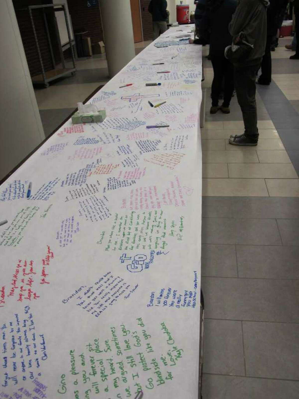 Hundreds of students, along with parents and teachers, staged an all-day vigil Saturday at Oxford High School for Brandon Giordano, who was killed in a crash late Friday night. In the lobby, students expressed their sorrow by writing on a 36-foot table covered with a long roll of paper. On Monday, grief counselors will be on hand to meet with students.