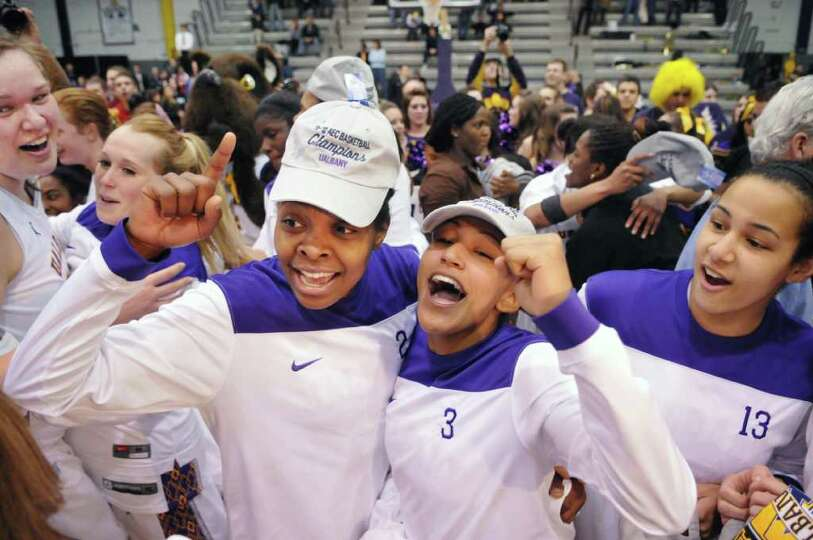 UAlbany women celebrate after beating UMBC for the championship of the America East at the SEFCU Are