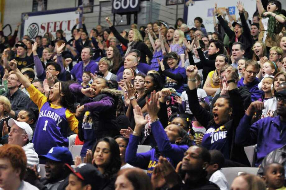 UAlbany fans cheer as their team beats UMBC  women for the championship of the America East at the SEFCU Arena in Albany Saturday  March 10, 2012. (John Carl D'Annibale / Times Union) Photo: John Carl D'Annibale / 00016692A