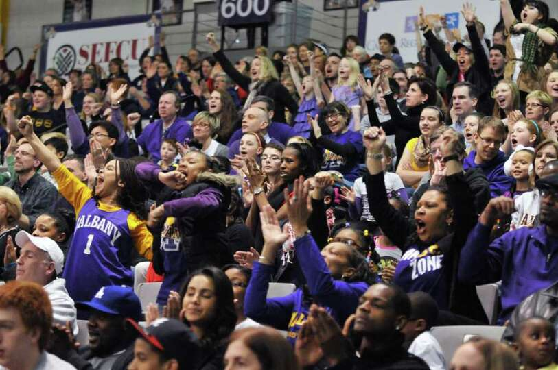 UAlbany fans cheer as their team beats UMBC  women for the championship of the America East at the S