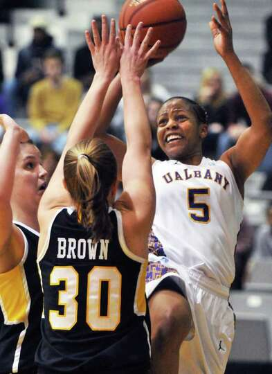 UAlbany's #5 Ebone Henry, at right, forces past UMBC defenders during the championship game of the A