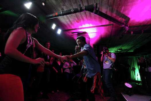 FOR METRO - Sarah Payton (left) dances with Austin Brown during his performance at the CNN Grill during South by Southwest Saturday March 10,  2012 in Austin, TX. Photo: EDWARD A. ORNELAS, SAN ANTONIO EXPRESS-NEWS / © SAN ANTONIO EXPRESS-NEWS (NFS)