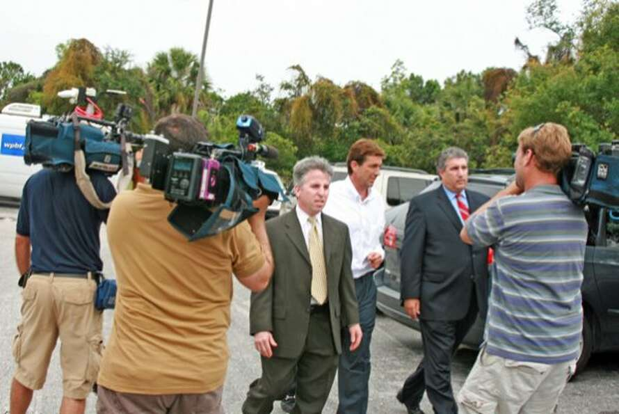 Elusive billionaire polo mogul John Goodman, accompanied by his lawyers, is released from Palm Beach