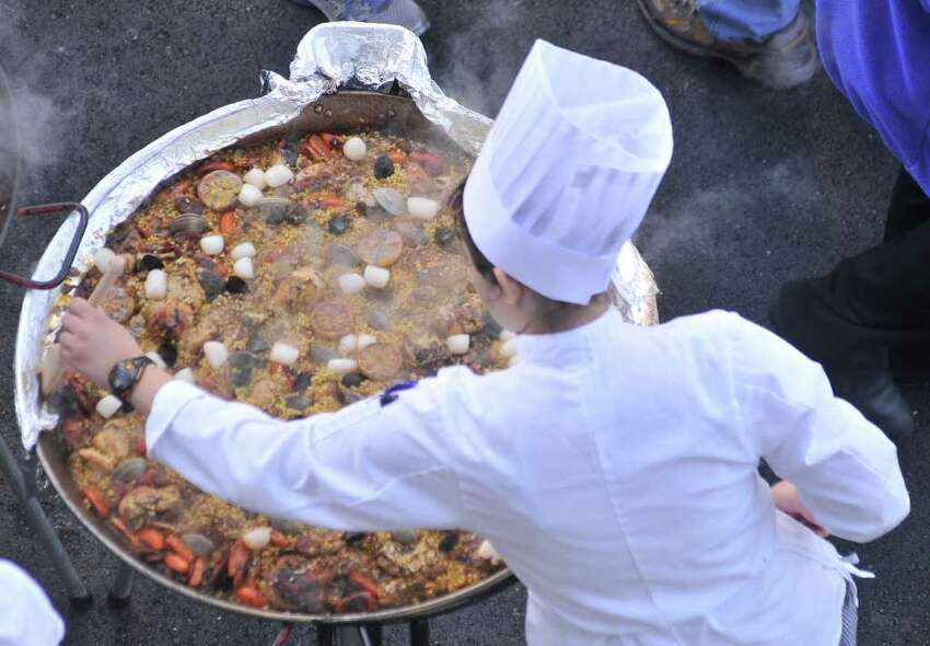 Chef's make paella during the Corona Paella Challenge at the Pearl Brewery Sunday.