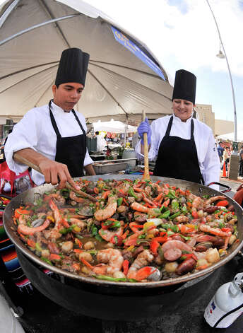 SLUG: Paella challenge-Photo request 56626-March 11, 2012-San Antonio, Texas---Chef's Jhojans Priego Zarate and Paola Torroella stir paella during the Corona Paella Challenge at the Pearl Brewery Sunday. Photo: ROBIN JERSTAD, SPECIAL TO THE EXPRESS-NEWS / SAN ANTONIO EXPRESS-NEWS