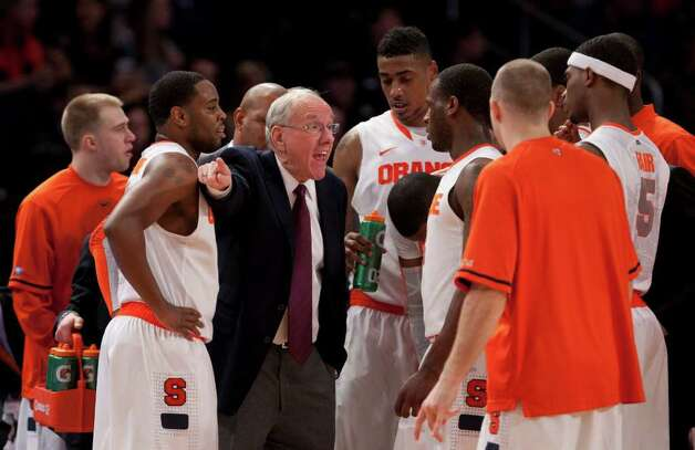 Syracuse University basketball Coach Jim Boeheim talks to his team in the first half against the University of Cincinnati during the semifinals of the Big East men's basketball tournament at Madion Square Garden in New York, March 9, 2012. The Cincinnati Bearcats got off to a torrid start Friday by jumping out to a 25-8 lead against the Syracuse Orange, and wound up holding on to advance to their first Big East championship game. (Richard Perry/The New York Times) Photo: RICHARD PERRY / NYTNS