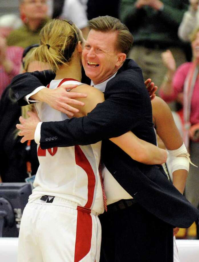 Sacred Heart coach Ed Swanson hugs Callan Taylor after their team's 58-48 victory over Monmouth in the NEC championship final women's basketball game in Fairfield, Conn., Sunday, March 11, 2012. (AP Photo/Fred Beckham) Photo: Fred Beckham, AP / Associated Press