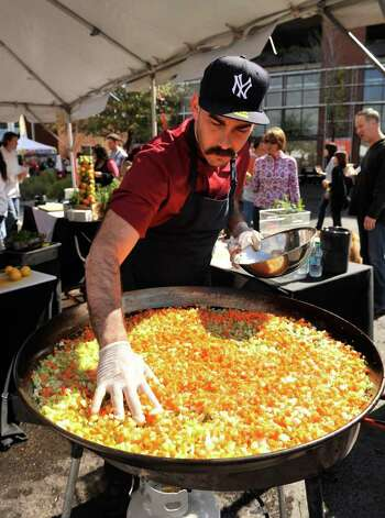 Chef Ty-Lor Boring, who appeared on Top Chef Texas, prepares his Paella during the Corona Paella Challenge at the Pearl Brewery Sunday. Photo: Robin Jerstad, Robin Jerstad/For The Express-News