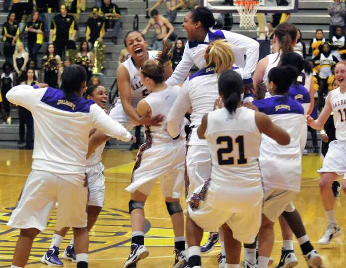 UAlbany women celebrate after beating UMBC for the championship of the America East at the SEFCU