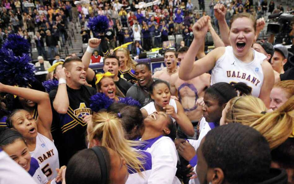 UAlbany womens basketball team and fans celebrate at center court after beating UMBC for the cham