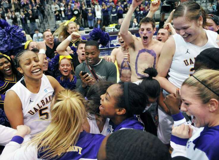 UAlbany womens basketball team and fans celebrate at center court after beating UMBC for the champio