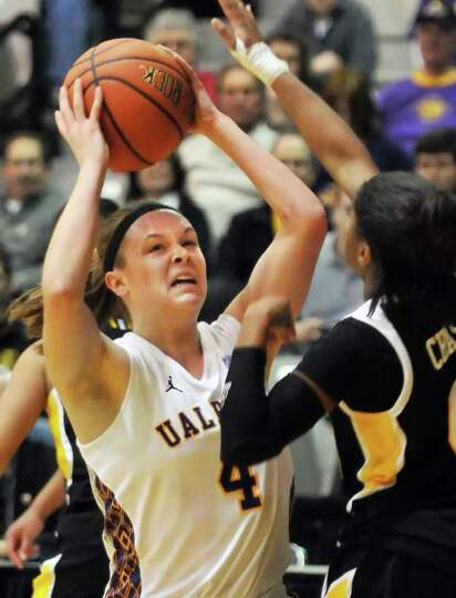 UAlbany's #4 Sarah Royals, left, shoots against UMBC's  during the championship game of the America