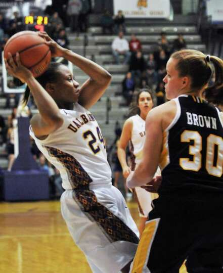 UAlbany's #24 Adrienne Jones, left, and UMBC's  #30 Erin Brown during the championship game of the A