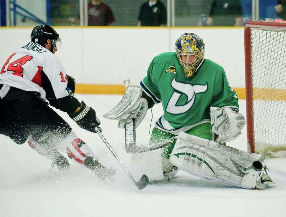 Brooklyn Aviators center Joe Dabkowski is robbed by Danbury Whalers goaltender Peter Vetri as he makes the save during a game played at the Danbury Arena. Sunday, Mar. 11, 2012 Photo: Scott Mullin / The News-Times Freelance
