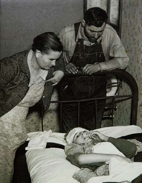 A photograph from the archives of the London Museum shows a child injured in the explosion.