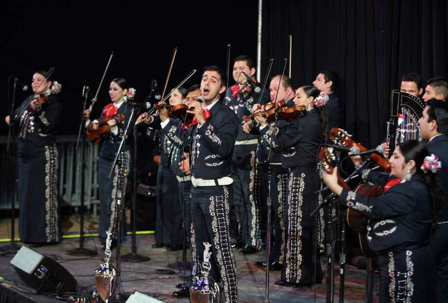 Mariachi Aztlan from Edinburg, Texas play after being announced winners of the Mariachi Contest at the Houston Livestock Show and Rodeo in Reliant Stadium Sunday, March 11, 2012, in Houston. Photo: James Nielsen, Chronicle / © 2012 Houston Chronicle