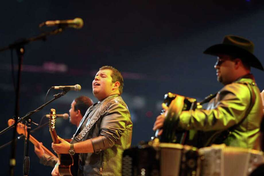 Making its third appearance at RodeoHouston, Duelo took the stage Sunday before a packed stadium. Photo: James Nielsen / © 2012 Houston Chronicle