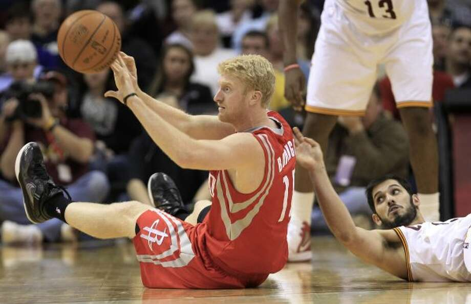 Rockets forward Chase Budinger, left, tosses the ball to a teammate in the fourth quarter. (Tony Dejak / Associated Press)