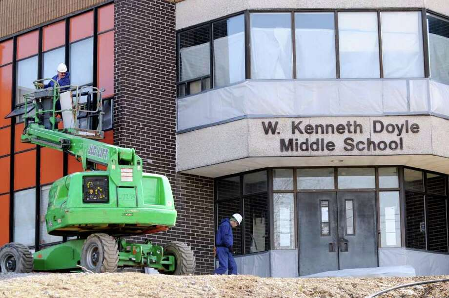 Construction workers at W. Kenneth Doyle Middle School on Wednesday, March 7, 2012, in Troy, N.Y. (Cindy Schultz / Times Union) Photo: Cindy Schultz / 00016710A
