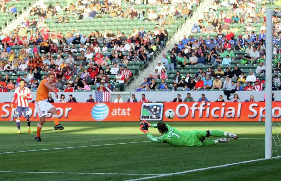 Andre Hainault beats Chivas USA keeper Dan Kennedy for Sunday's lone goal. Photo: Victor Decolongon / 2012 Getty Images
