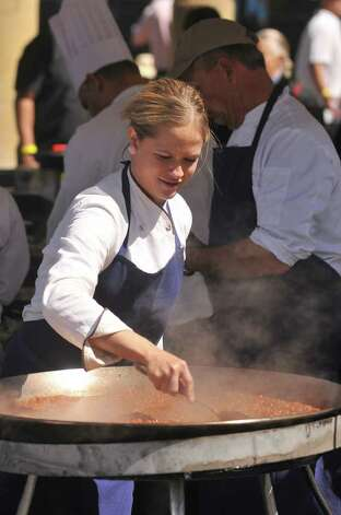 Top Chef Texas contstant Lindsay Autry prepares her Paella at the Corona Paella Challenge Sunday at the Pearl Brewery. Photo: Robin Jerstad, Robin Jerstad/For The Express-News