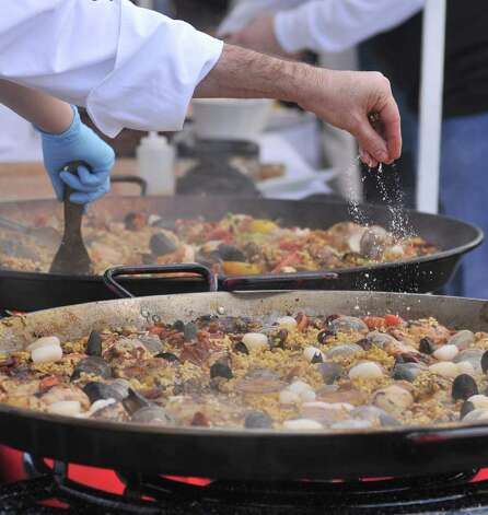 Chef's make paella during the Corona Paella Challenge at the Pearl Brewery Sunday. Photo: Robin Jerstad, Robin Jerstad/For The Express-News