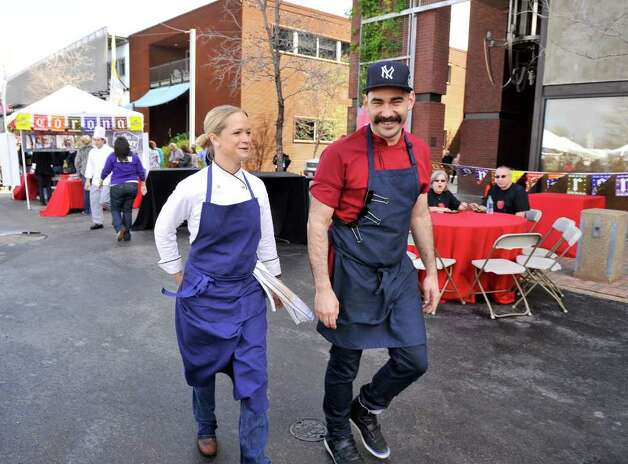 Chef's Lindsay Autry and Ty-Lor Boring, both of whom were contestants on Top-Chef Texas, stroll through the Pearl Brewery during the Corona Paella Challenge  Sunday. Photo: Robin Jerstad, Robin Jerstad/For The Express-News