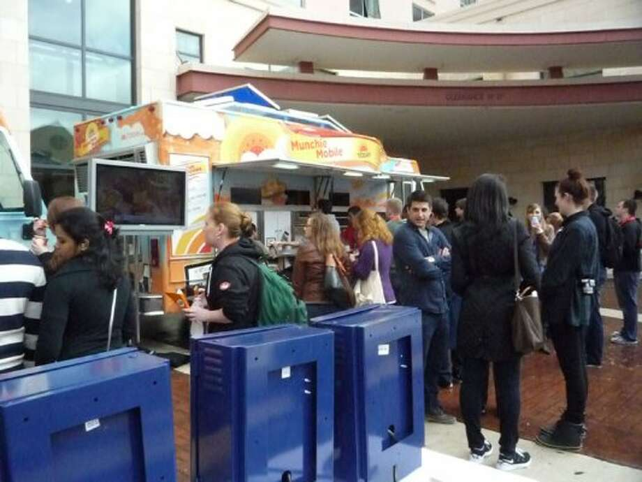 With no rain in sight, attendees enjoy the outdoors, and some free food, on Day 3 of SXSW's Interactive Conference.