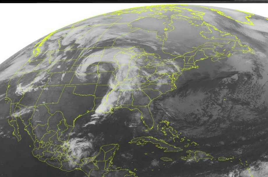 This NOAA satellite image taken Monday, March 12, 2012 at 12:45 a.m. EST shows distinct, comma, shaped cloud cover over the Midwest.  This cloud cover highlights a low pressure system taking shape over the nation's mid-section. This system draws moisture from the Gulf of Mexico and produces areas of showers and thunderstorms from the Louisiana and Mississippi casts northward to parts of the Upper Great Lakes and Upper Mississippi Valley and back into the Central Plains.  (AP PHOTO/WEATHER UNDERGROUND) / WEATHER UNDERGROUND