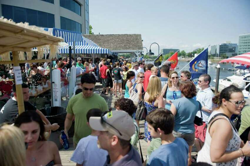 People gather at the The Crab Shell at Stamford Landing Marina to enjoy the Stamford Harbor Live event in Stamford, Conn. on Saturday May 28, 2011.