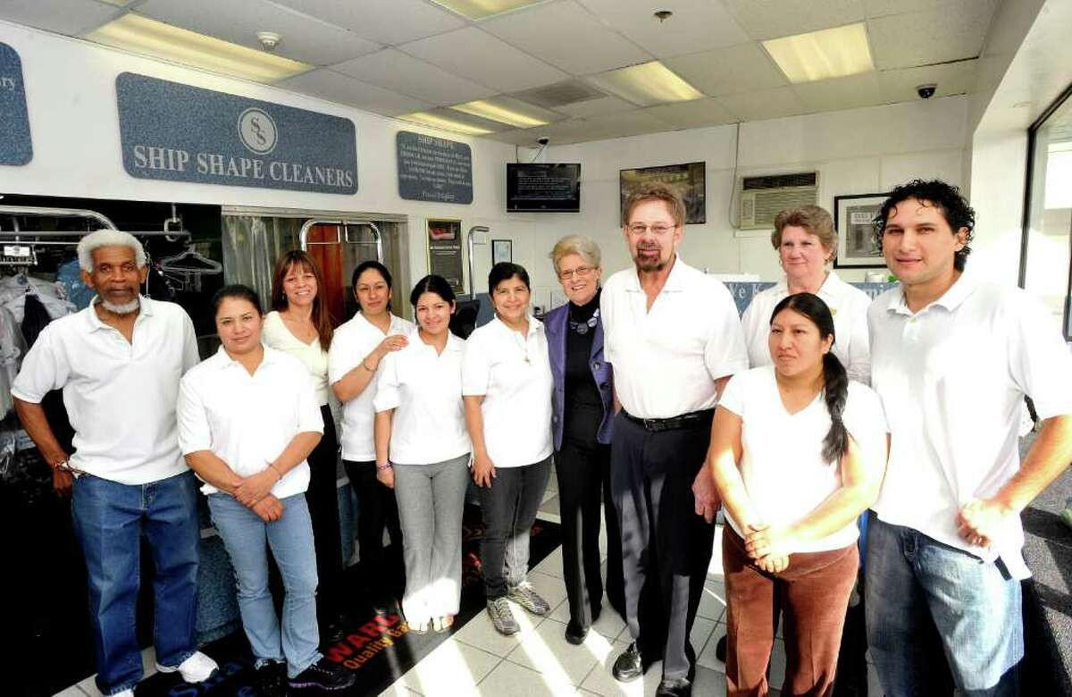 Paul and Roberta Bagley, fourth and fifth from right, stand with the staff in their Brookfield business Ship Shape Cleaners Monday, March 12, 2012.