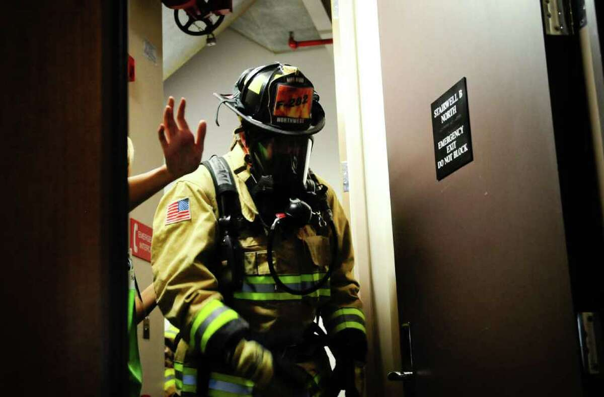 A firefighter exits the stairwell at the 40th floor of the Columbia Center to change oxygen bottles during the Scott Firefighter Stairclimb in Seattle on Sunday, March 11, 2012. 1,550 firefighters from the U.S., Canada and Germany participated in the climb, which requires participants to scale 69 flights of stairs and 1,311 steps equaling 788 ft. of vertical elevation. The annual climb is the largest in the world.