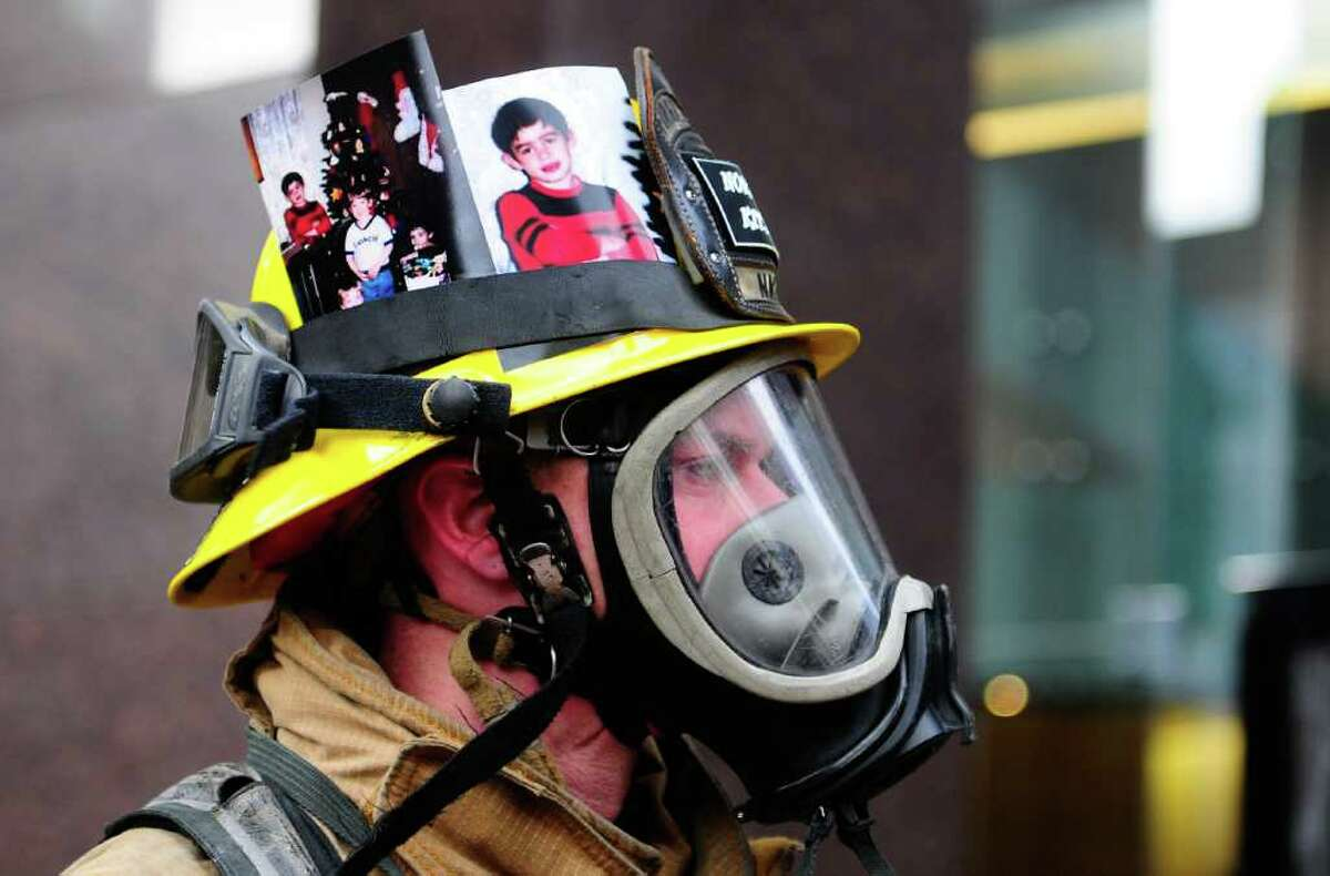 North Kitsap firefighter Shane Seyboldt displays a photo of his brother, who died of leukemia at a young age, on his helmet outside the Columbia Center in Seattle during the Scott Firefighter Stairclimb on Sunday, March 11, 2012. 1,550 firefighters from the U.S., Canada and Germany participated in the climb, which requires participants to scale 69 flights of stairs and 1,311 steps equaling 788 ft. of vertical elevation. The annual climb is the largest in the world.