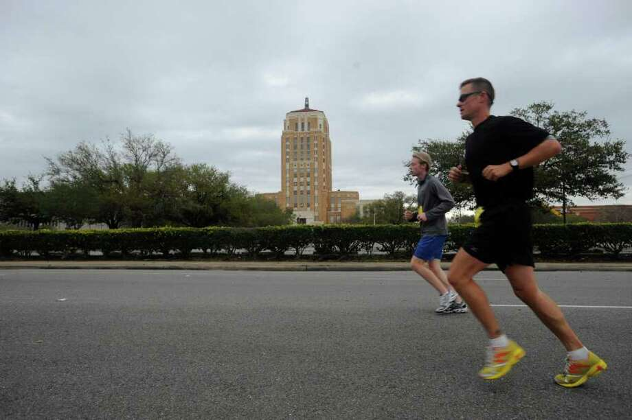 Runners make their way through downtown Beaumont during the Gusher Marathon, Saturday March 10, 2012.  Dave Ryan/The Enterprise