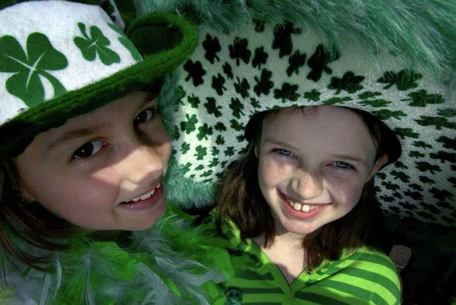 Cousins 12-year-old Erica Burton, left, and 10-year-old Sydney Burton of Poestenkill wear the green during  Albany's  St. Patrick's Day Parade in Albany, New York, in 2009. ( Michael P. Farrell / Times Union archive ) Photo: MICHAEL P. FARRELL / 00002851A