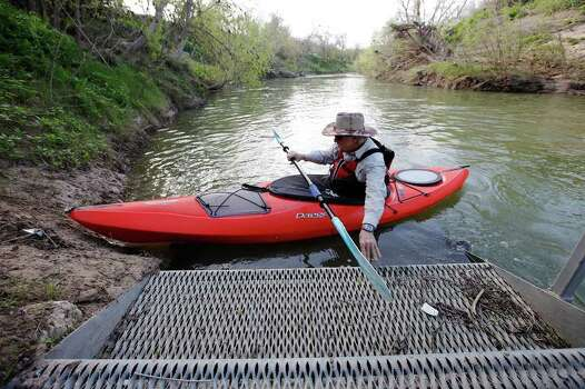 Kayaker Kenny Munn pushes off the steps of the put-in to be one of the first people to paddle along the San Antonio River at the new 12-mile Saspamco Paddling Trail in South Bexar County near Elemendorf on Saturday, Mar. 3, 2012. Kin Man Hui/Express-News Photo: Kin Man Hui, San Antonio Express-News / © 2012 San Antonio Express-News