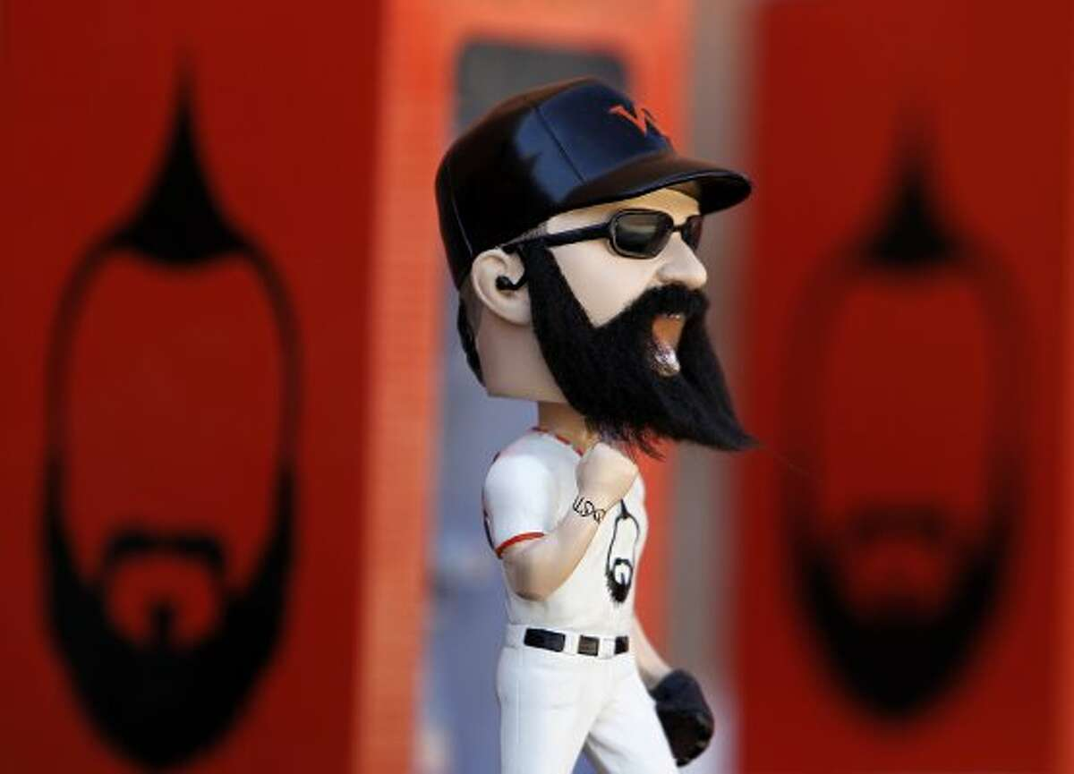 Brian Wilson bobbleheads are sold before the San Francisco Giants Cactus League spring training opener against the Arizona Diamondbacks in Scottsdale, Ariz. on Saturday, March 3, 2012. (The Chronicle)