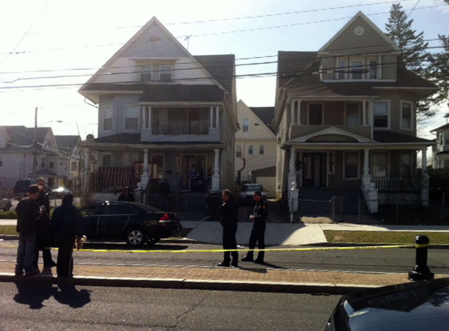 Bridgeport police at the scene of a shooting on Park Ave. Monday afternoon. An unidentified man was rushed to Saint VincentâÄôs Medical Center after being shot several times while sitting on a porch. Photo: Daniel Tepfer / Connecticut Post