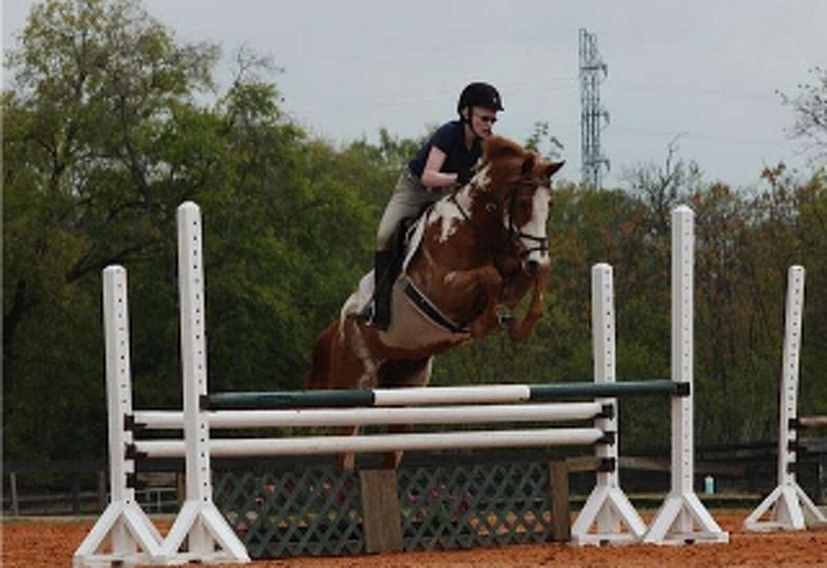 Kat McClellan, shown on her horse Fighting Colors, trains at the Oakwell Farms Equestrian Center.