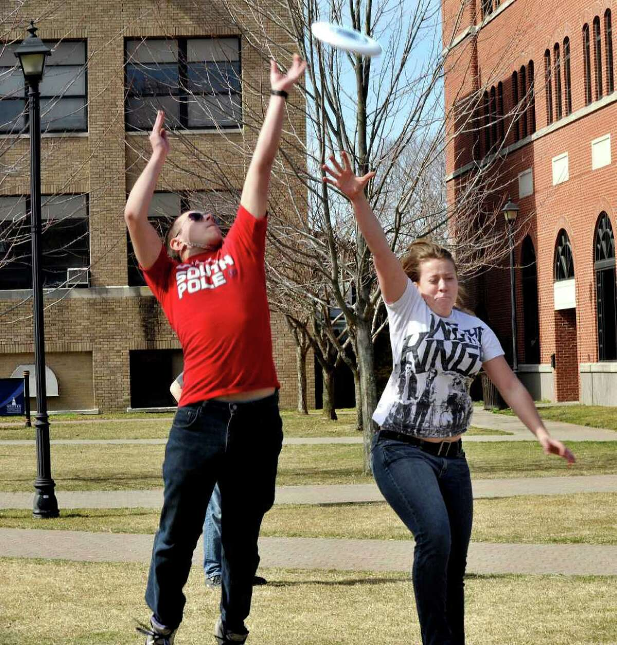 Tyler Cappiello, 20, of Brookfield, and Lauren Allen, 18, of Fairfield, compete for a Frisbee during an afternoon game at Western Connecticut State University's midtown campus Monday, March 12, 2012.