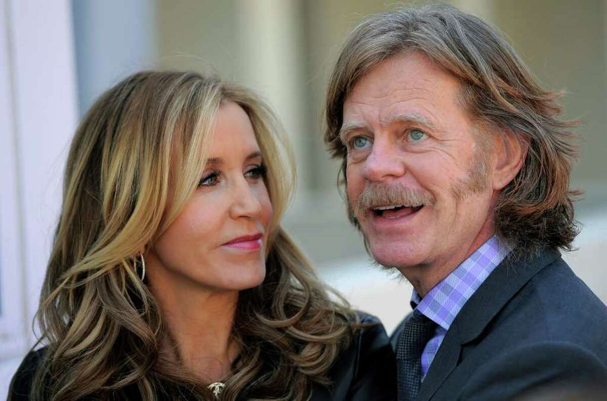 Married actors Felicity Huffman, left, and William H. Macy are interviewed following a rare double star ceremony on the Hollywood Walk of Fame in Los Angeles, Wednesday, March 7, 2012. The only other couple to be honored with stars on the same day were film producers Lauren Shuler Donner and Richard Donner on October 16, 2008. (AP Photo/Chris Pizzello)