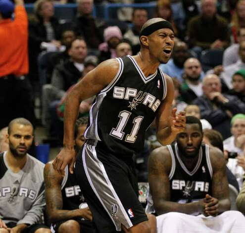FILE - In this Jan. 10, 2012 file photo, San Antonio Spurs' T.J. Ford grimaces after an injury against the Milwaukee Bucks during the first half of an NBA basketball game,  in Milwaukee. Ford is retiring, effective immediately, after a series of neck and spine injuries during eight years in the NBA. The 28-year-old Ford announced his decision Monday, March 12, 2012, on Twitter. Photo: AP