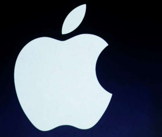 In this photo taken March 7, 2012, the Apple logo is projected during an announcement in San Francisco. (AP Photo/Paul Sakuma) Photo: Paul Sakuma