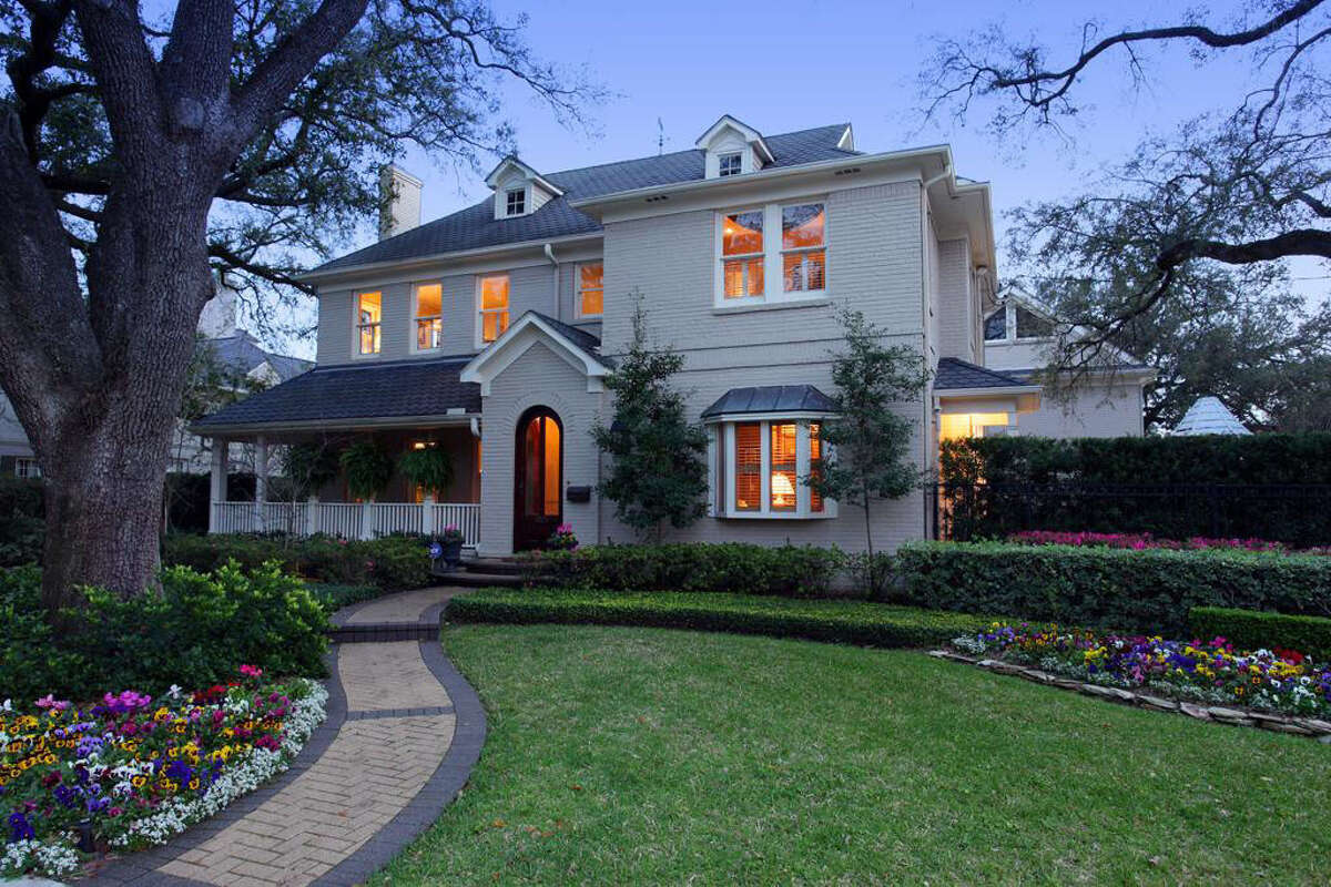 A look at the front exterior of the home, spotlighting the beautiful landscaping of the property.