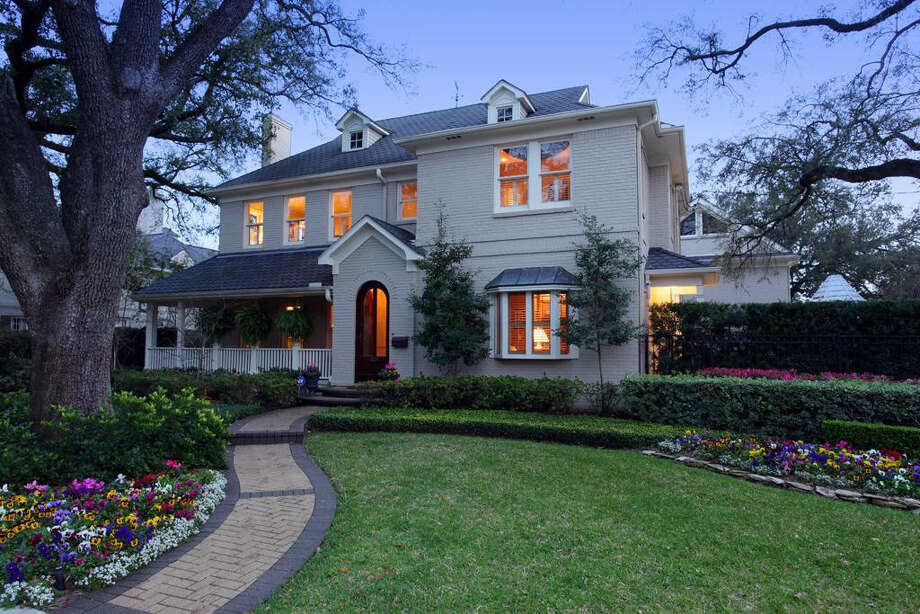 A look at the front exterior of the home, spotlighting the beautiful landscaping of the property. Photo: Realtor.com