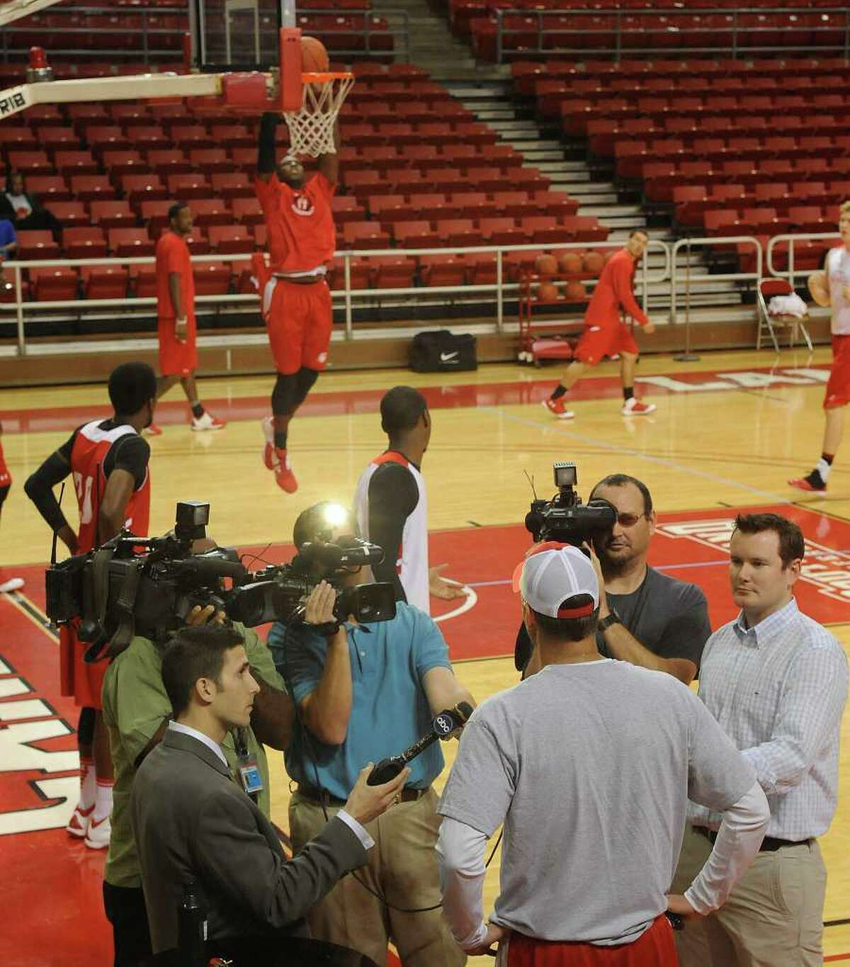 First year Head Coach Pat Knight, center with hands on his hips, talks to the media Monday afternoon while his team warms up for practice. After practice, the Lamar University Cardinal basketball team was leaving the Montagne Center and heading to the Jack Brooks Regional Airport in Nederland to fly to Dayton Ohio for their first NCAA tournament game against Vermont. Dave Ryan/The Enterprise