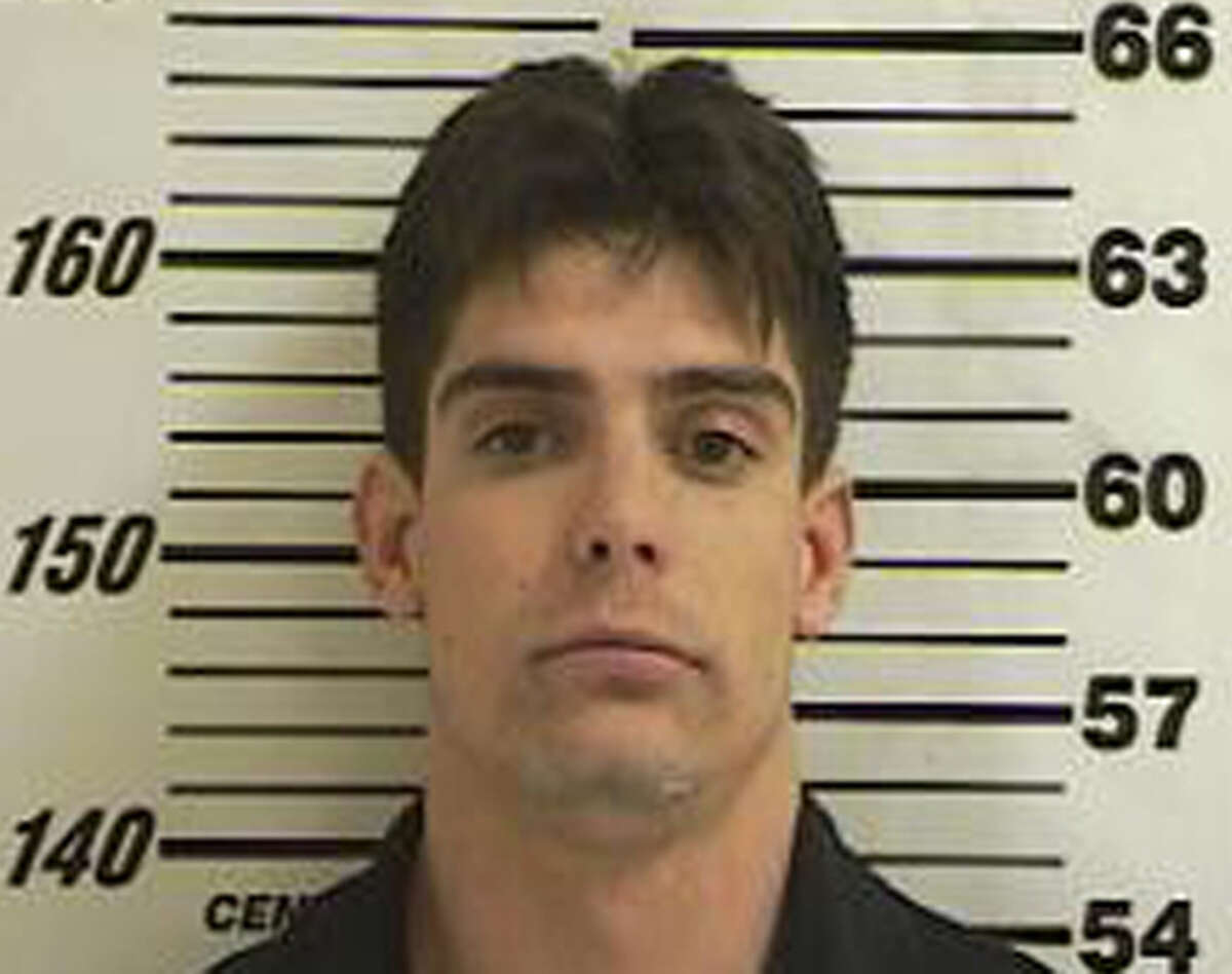 This police booking photo provided by the Davis County Sheriff's Office shows Jeremy Blair, 26, of Kaysville, Utah. Blair's father persuaded his son to surrender to authorities after recognizing him as a suspect in a computer store burglary while watching a TV news program, officers said. (AP Photo/Davis County Sheriff via KSL-TV)