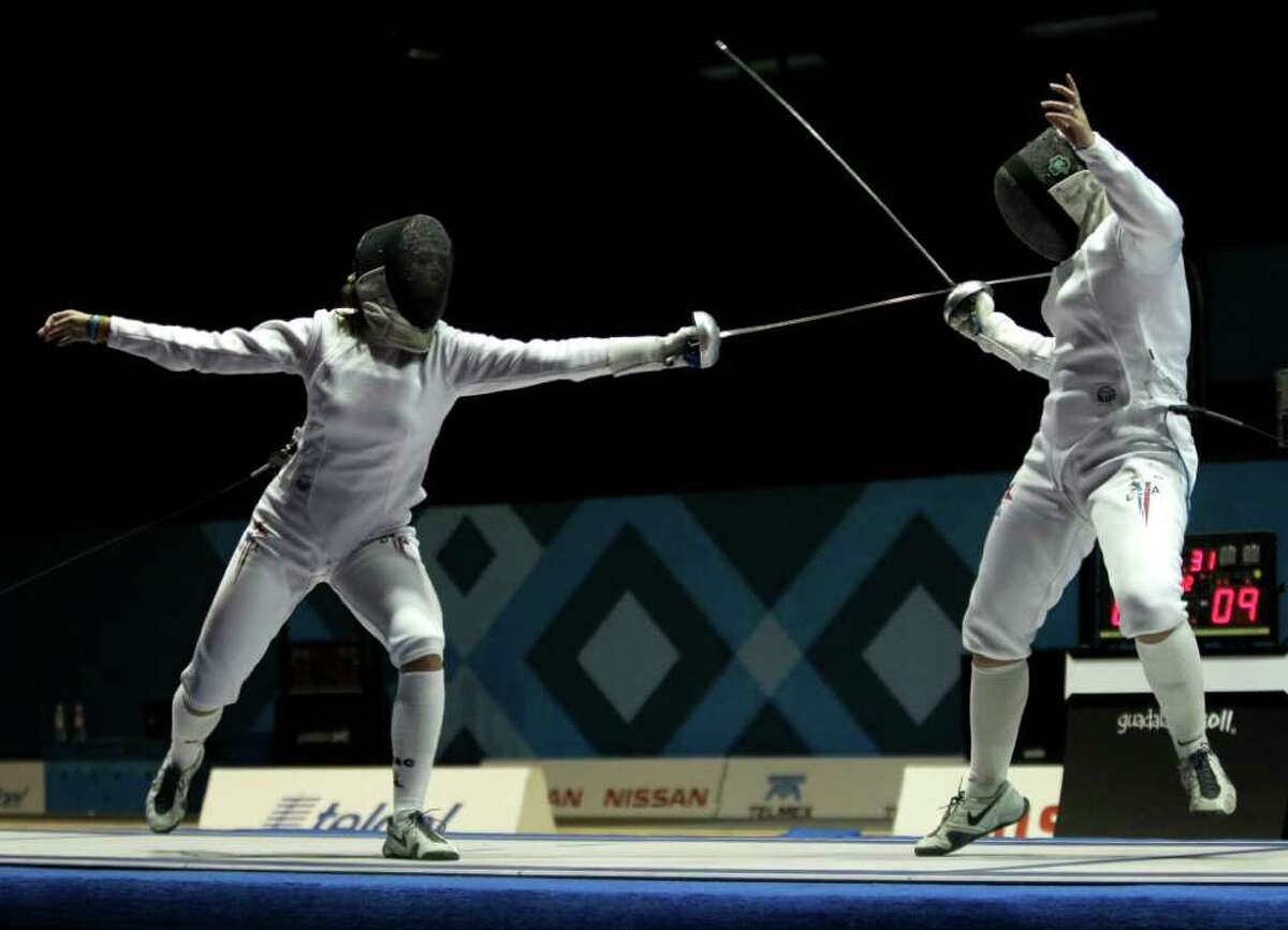 San Antonio sisters Kelley and Courtney Hurley battle during a fencing women's individual epee final bout at the Pan American Games in Guadalajara, Mexico, on Oct. 26. Courtney won the gold medal.