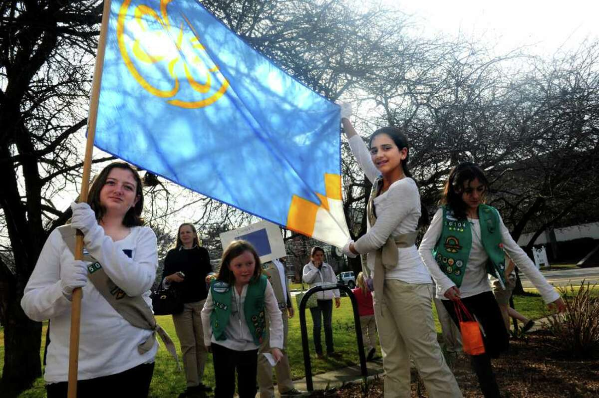 Molly Cohen, 11, and Jenna Pastore, 12, hold the Girl Scouts flag at a ceremony celebrating the 100th year of Girl Scouting in the United States in front of the Greenwich Town Hall Monday, March 12, 2012.